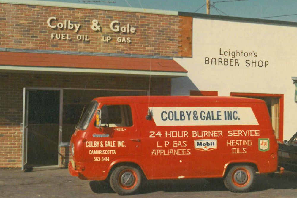 An old photo showing Leighton's Barber Shop next to Colby & Gale.