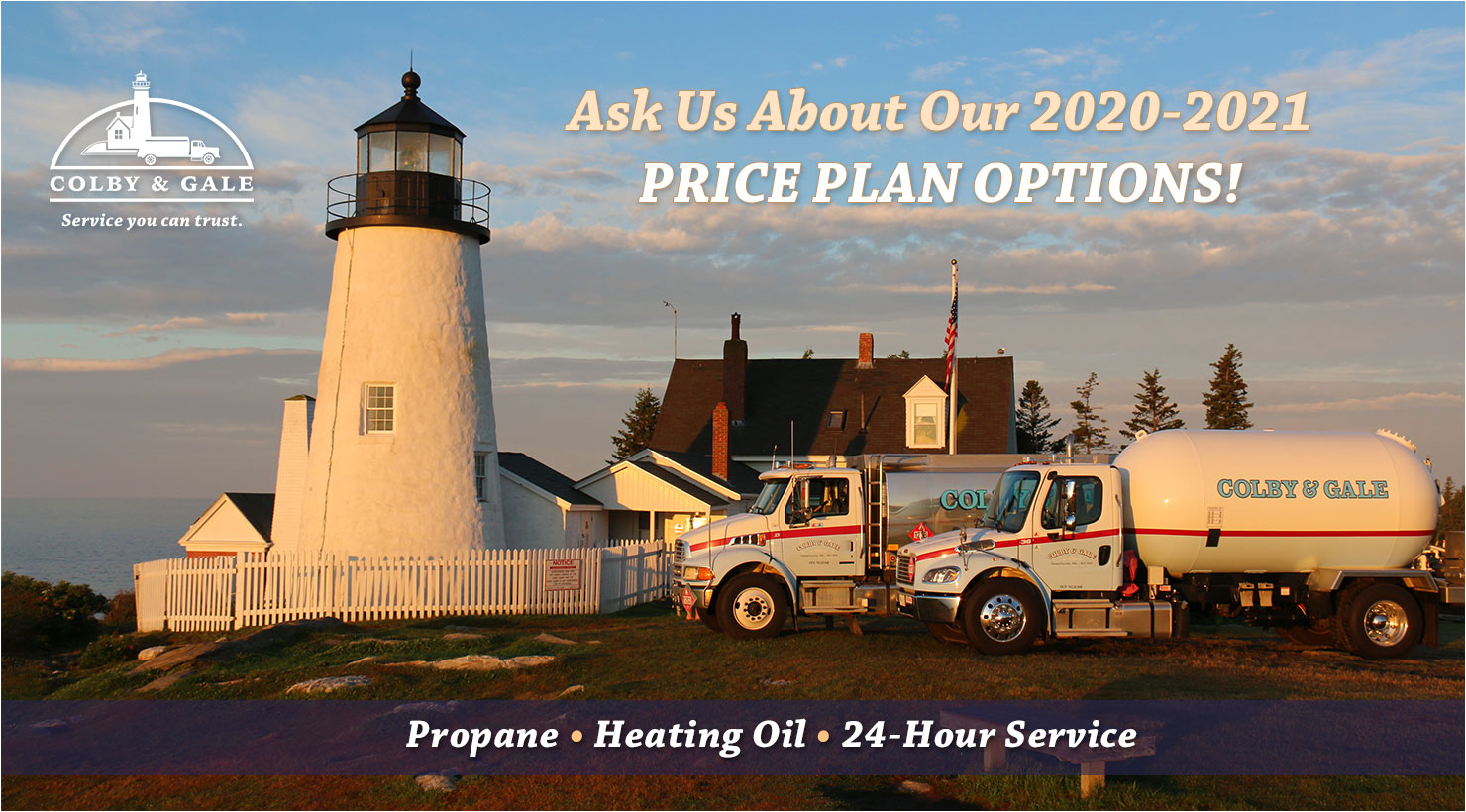 A photo of Pemaquid Point Lighthouse in Maine with Colby & Gale trucks in front.