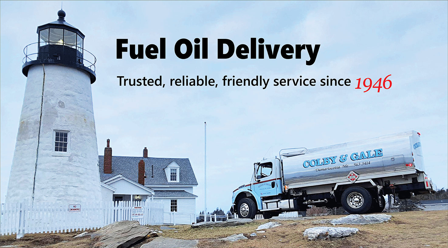 Fuel and oil delivery truck by a lighthouse in Maine